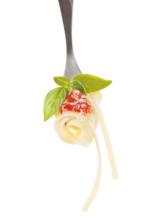 Pasta with tomato sauce, basil and parmesan cheese on fork isolated on white. Traditional italian food.