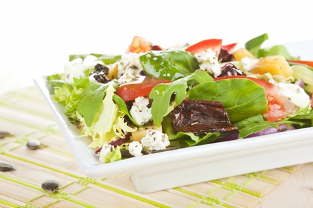Salad. Fresh mix salad with goat cheese, dried tomatoes and other fresh vegetables. photo