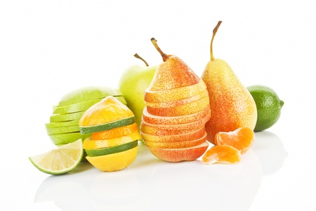 Colorful summer background. Apple, pear, lime and tangerine pieces, slices and whole fruit isolated. Stock Photo - 9835173