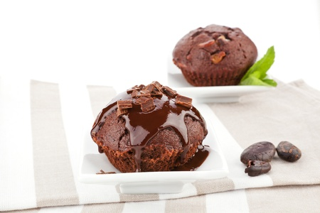 Delicious chocolate muffins with chocolate garnish. photo