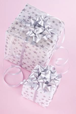beautifully wrapped: Beautifully wrapped christmas gifts on pink background. Christmas background.