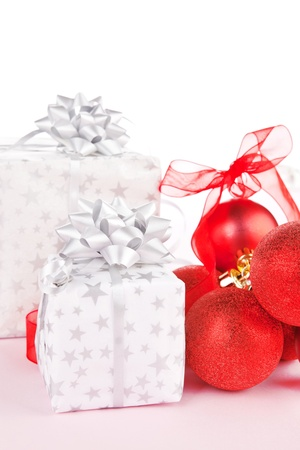 beautifully wrapped: Luxurious christmas background. Red balls and beautifully wrapped presents.
