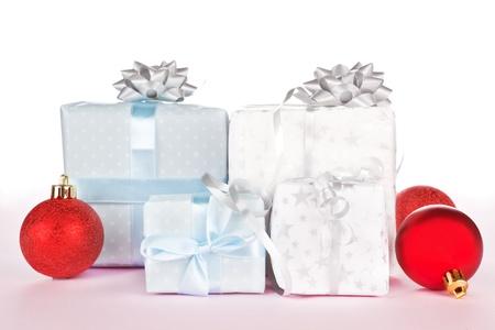 beautifully wrapped: Beautifully wrapped christmas gifts with red christmas balls. Christmas background. Stock Photo