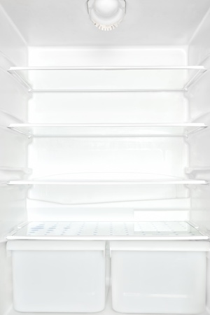 refrigerator: Open empty white refrigerator. Unhealthy eating disorder concept.