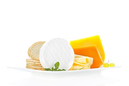Luxurious cheese variation on white tray isolated on white background. Luxurious cheese still life background. Stock Photo