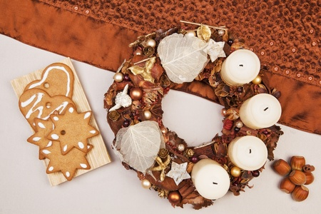 Traditional christmas still life with xmas crown, gingerbread cookies and nuts. Brown traditional natural concept. photo
