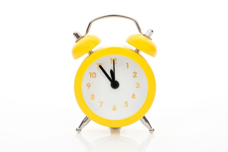 just in time: Yellow alarm clock isolated on white background. Just in time concept. Stock Photo