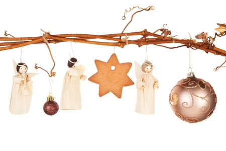 Traditional natural christmas still life. Bethlehem, the birth of Jesus and the three king with star shaped gingerbread cookie hanging from vineyard branch.