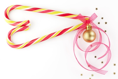 Christmas background with copy space made of candy cane in heart shape, christmas ball and ribbon. Beautiful xmas copy space. Stock Photo - 11307387