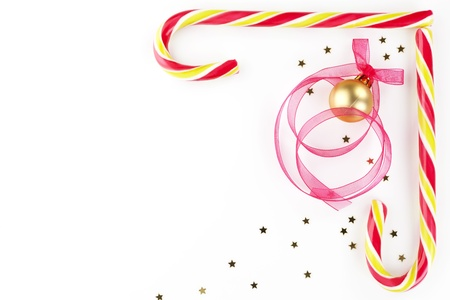Christmas background with copy space made of candy cane, golden stars, christmas ball and ribbon. Beautiful xmas copy space. Stock Photo - 11307385