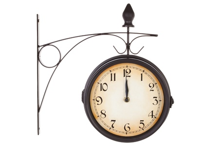 Classic vintage railway station clock isolated on white background. Retro antique timepiece. Stock Photo