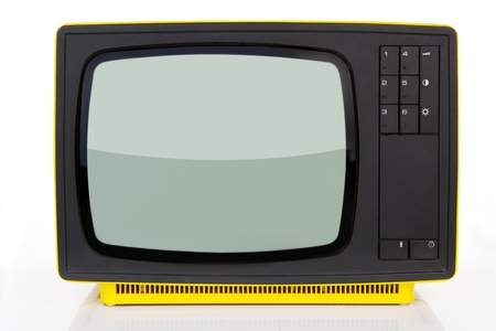 Old yellow retro styled television from 1970s isolated on white background. Retro concept. photo
