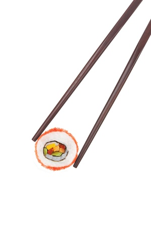 Holding a california maki sushi piece with chopsticks isolated on white background. Culinary gourmet japanese food.  Stock Photo