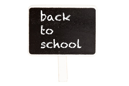 Back to school text on blackboard isolated on white background with clipping path. Education concept. photo