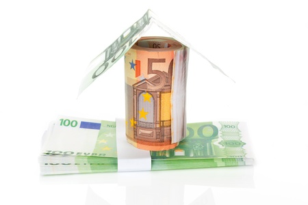 House made of fifty and hundred EUR notes isolated on white background. Home financing concept. photo