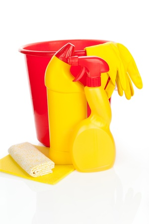 Cleaning products - bucket, gloves and sponge in yellow and red isolated on white background. Purity concept. photo