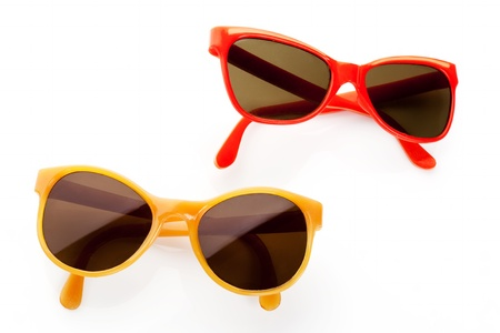 Two retro sunglasses from the eighties  Red and yellow frame  Vintage objects