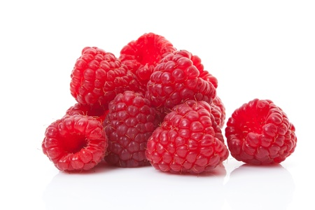 Delicious ripe raspberries group isolated on white background. Luxurious healthy summer fruits.