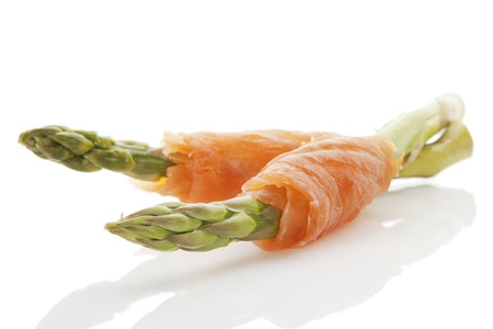 Fresh asparagus and smoked salmon pieces isolated on white background. Culinary healthy light eating. photo