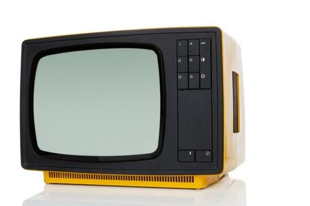 Yellow retro television isolated on white background  Retro objects  photo