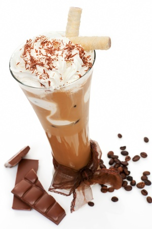 Luxurious delicious iced coffee with foam with chocolate and coffee beans isolated on white  Cool summer drink concept  photo