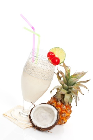 Delicious cocktail pina colada with coconut and pineapple isolated on white background. Cool summer drinks.