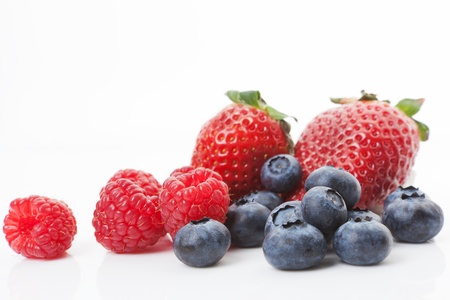 Blueberries, raspberries and strawberries isolated on white background  Sweet summer fruits