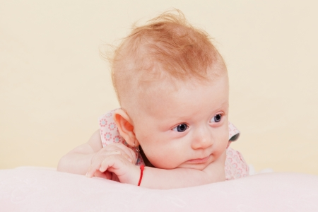 1 2 month: Cute blond newborn baby girl lying on blanket thinking  Beautiful baby concept  Stock Photo