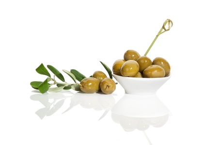 Delicious green olives with fresh branch isolated on white background  Culinary tapas eating