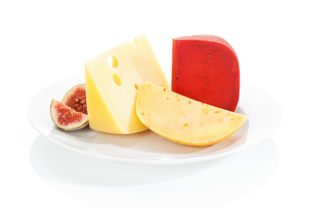 Luxurious cheese assortment with fig on white plate  Gouda chili, swiss cheese and gouda  Culinary eating Stock Photo - 14233067