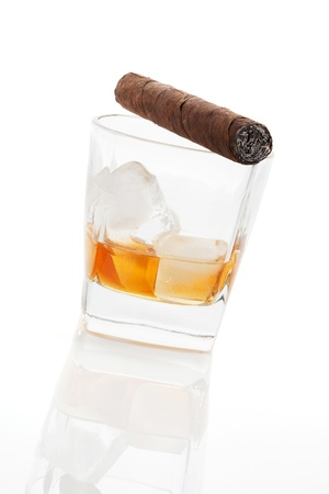 Alcohol and tobacco  Addiction concept  Whiskey and cigar isolated on white background  photo