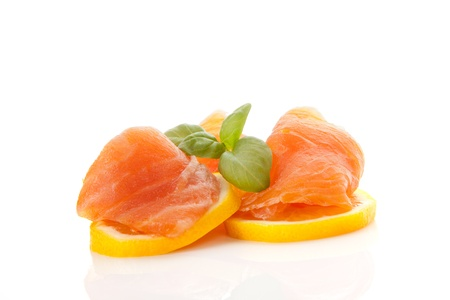 Delicious raw salmon with fresh lemon slices and fresh herbs basil  Culinary seafood background   photo