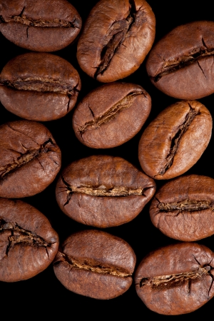Delicious coffee beans isolated on black background  Top view  Culinary aromatic background  photo