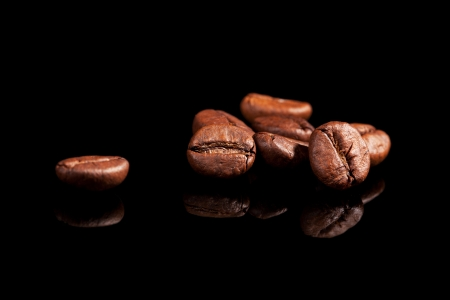 coffee grains: Luxurious aromatic coffee beans on black background  Luxurious coffee concept