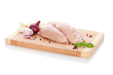 Delicious raw chicken breast steak with onion, garlic and peppercorns  Culinary cooking ingredients