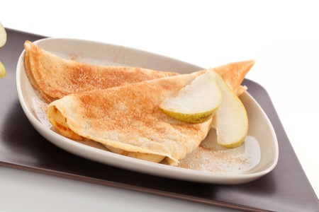 Delicious pancakes with fresh pear and cinnamon  Luxurious sweets, minimal style  photo