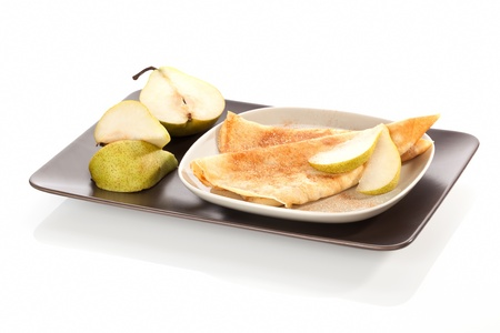 Delicious pancakes with cinnamon and fresh pears on plate isolated on white background  Culinary sweet dessert  photo