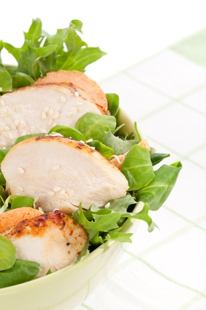 cornsalad: Delicious salad with chicken pieces in green bowl. Luxurious light summer eating.