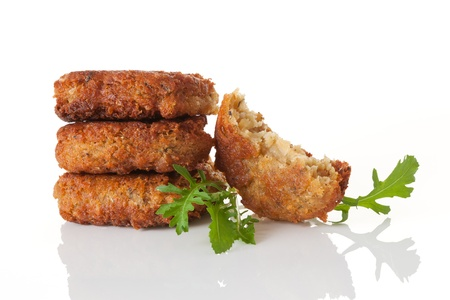 Delicious falafel patty pile with fresh herbs isolated on white background  Culinary arab vegan eating