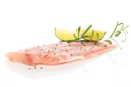 pangasius: Delicious fish fillet with fresh herbs and lime isolated on white background  Culinary seafood eating