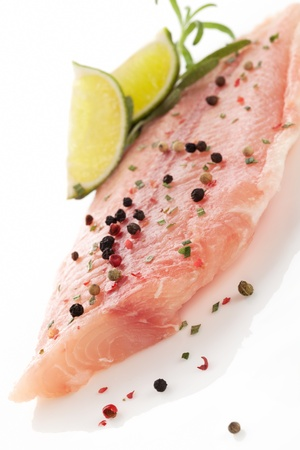pangasius: Delicious raw fish fillet with lime, fresh herbs and colorful peppercorns  Culinary seafood eating