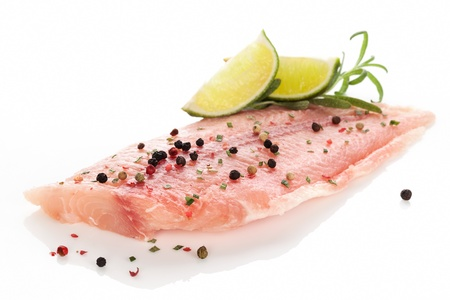 pangasius: Delicious raw fish fillet with colorful peppercorn, lemon and fresh rosemary isolated on white  Culinary fish eating  Stock Photo