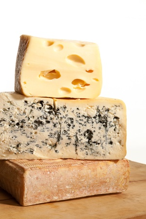 Three huge various cheese black on wooden background. Culinary cheese background. photo