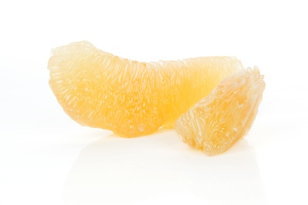 Two peeled pomelo pieces isolated on white background  Tasty fresh fruit eating concept  Stock Photo - 17600212