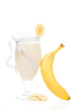 Delicious banana shake with fresh banana isolated on white background. Fresh summer drink. Stock Photo - 17709574