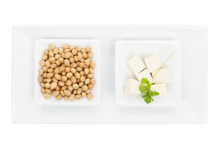 Tofu and soybeans in white bowls isolated on white background  Culinary vegan and vegetarian eating concept  photo