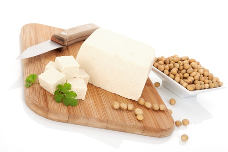 Tofu and soybeans on wooden kitchen board  Culinary vegan eating  Delicious soy background   photo