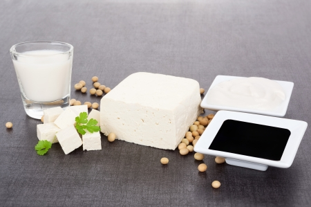 Soy products  Tofu, soy milk, soybeans, soy sauce and soy cream on dark black and grey background  Vegetarian and vegan eating  photo