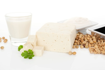 Soy milk, tofu, soybeans, granules and soy sauce isolated on white background  Culinary vegetarian and vegan eating background