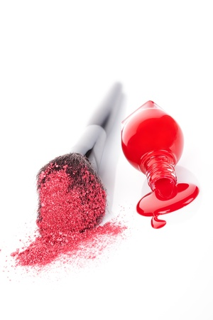 Luxurious cosmetics background in red and white  Red nail polish and makeup brush with pink powder isolated on white background  Feminine beauty concept Stock Photo - 18628144